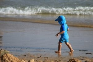 Kid Walking In Sand